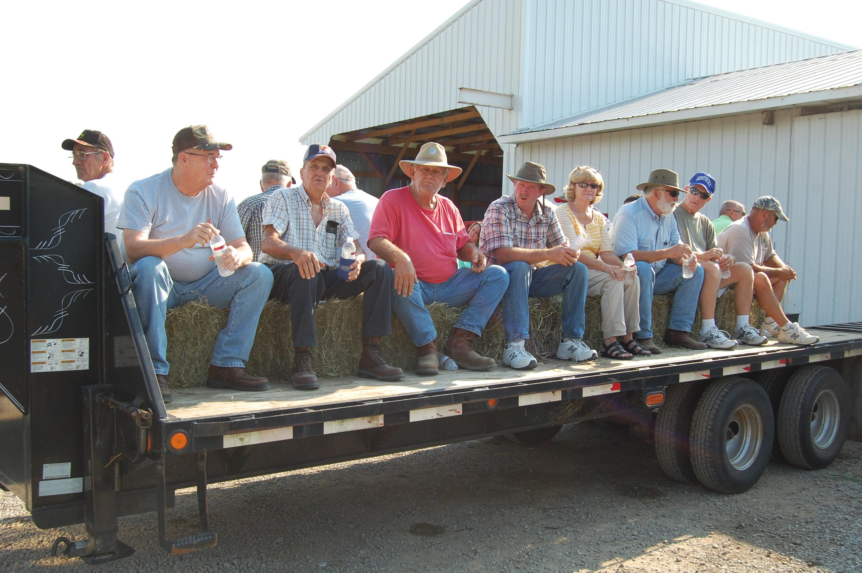 Attendees load wagon for hay ride.